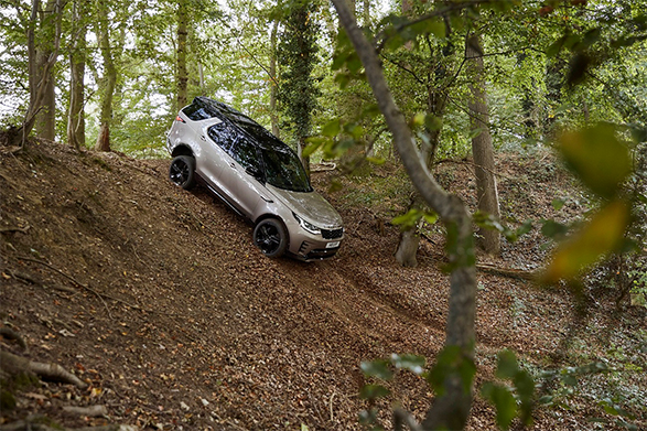 Land Rover Discovery driving down a steep hill